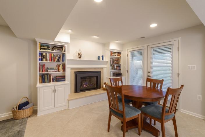 Annandale basement remodel with custom bookshelves