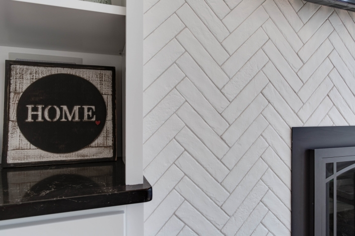 Fairfax, VA, fireplace wall, interior remodel, with MSI tile in Watercolor Bianco Chevron pattern