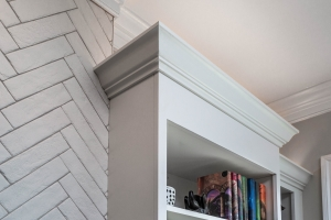 Fireplace wall, interior remodeling, Fairfax, VA, built-in shelving next to Chevron wall