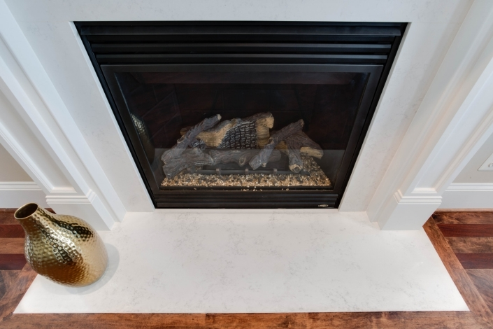 Fairfax, VA, fireplace update with gas fireplace insert and MSI Quartz hearth
