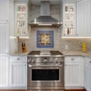 Alexandria Kitchen Remodel with Crystal Current countertops, Dal Tile ceramic backsplash and Dal Tile Nautical Blue deco tiles