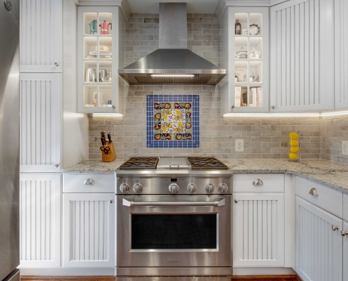 Alexandria Kitchen Remodel with Crystal Current countertops, Dal Tile ceramic backsplash and Dal Tile Nautical Blue deco tiles