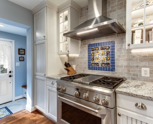Alexandria Kitchen Remodel with ceramic tile backsplash and Crystal Current cabinets with Amerock pulls
