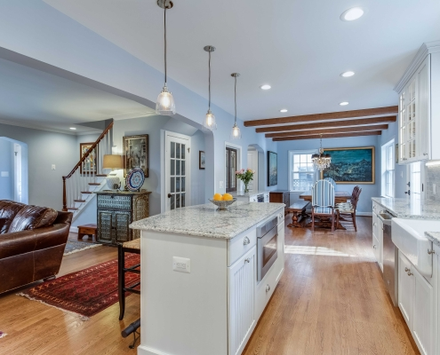 kitchen remodeling, Alexandria VA with custom island and cabinetry with Ceasarstone countertops and custom beams for dining room ceiling