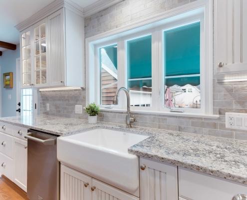 remodeling Alexandria, VA custom kitchen with Kohler Whitehaven farmhouse style sink and Kohler Single handle pull out spray