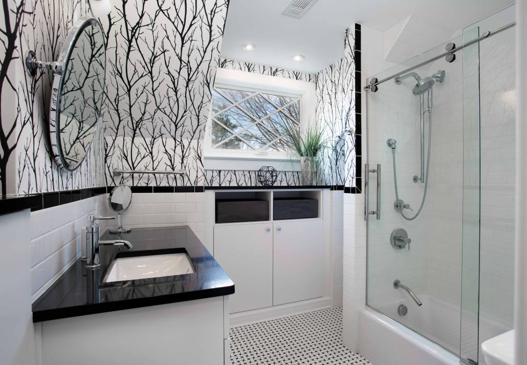 Alexandria Bathroom Remodel with custom black forest wallpaper and Kohler shower and tub fixtures with basketweave tile floor