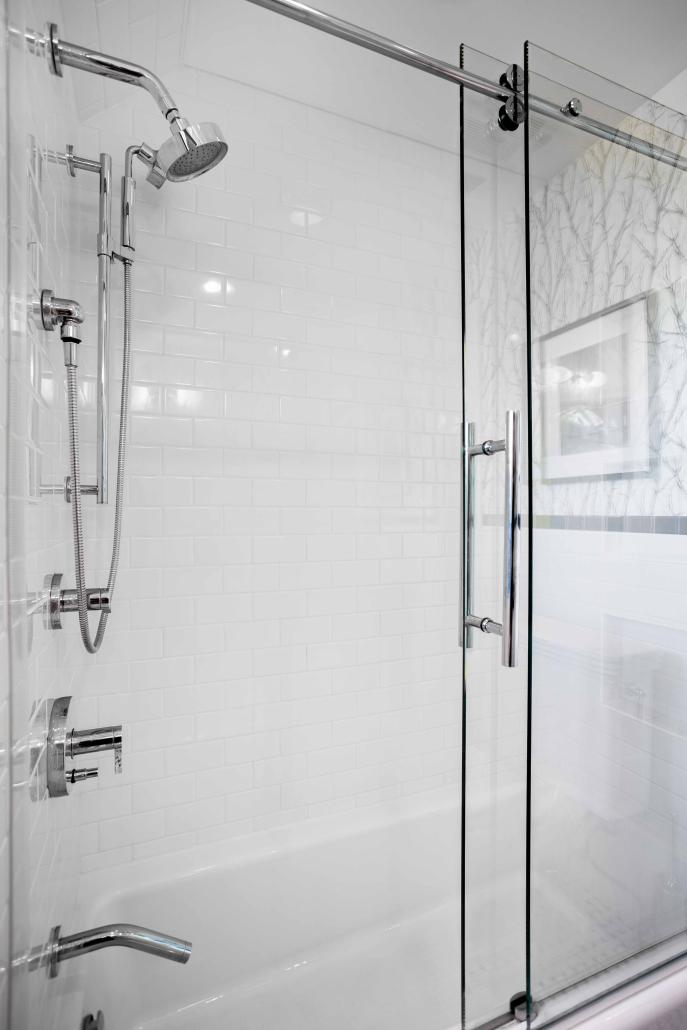 Custom bathroom remodeling, Alexandria, VA with Century Centec sliding barn door and Kohler shower fixtures