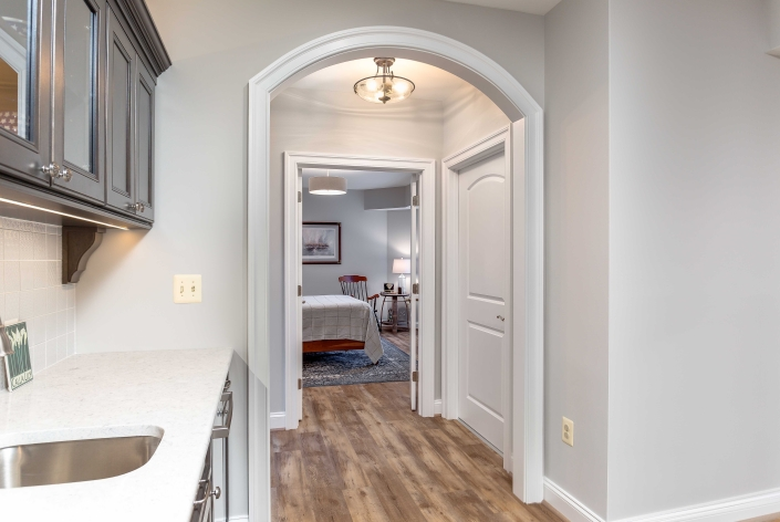 Alexandria Basement remodel, Foster Remodeling Solutions, custom arched hallway with Solid Core doors and kichenette