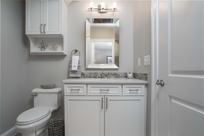 Basement bathroom, bathroom remodeling, Alexandria, VA with Waypoint vanity and Top Knobs hardware with Kohler toilet
