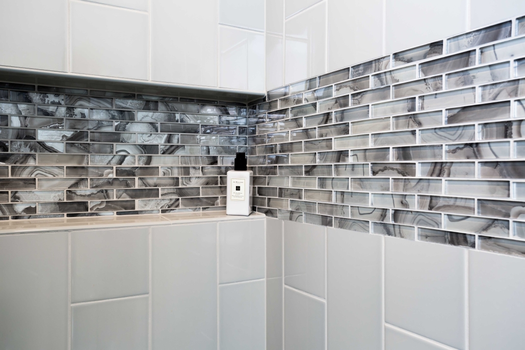 Shower installation, basement remodeling, Alexandria, VA with custom glass tile work in shower