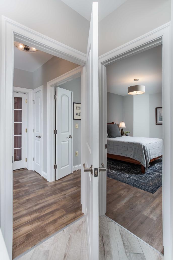 Custom in-law suite, basement remodeling with Solid Core doors, European LVP flooring and Benjamin Moore paint