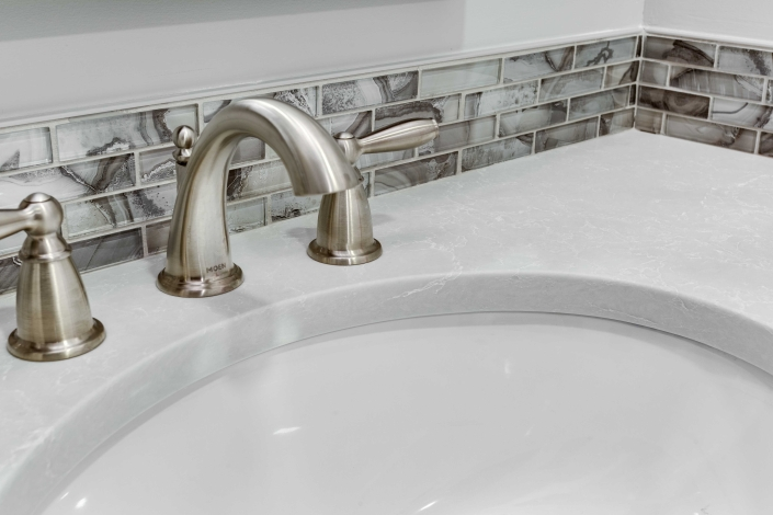 Alexandria Basement Suite, bathroom installation with Delta faucet and deco glass tile