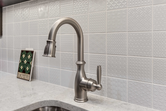 Alexandria Basement Suite with Mosaic Spirit White backsplash and Moen faucet