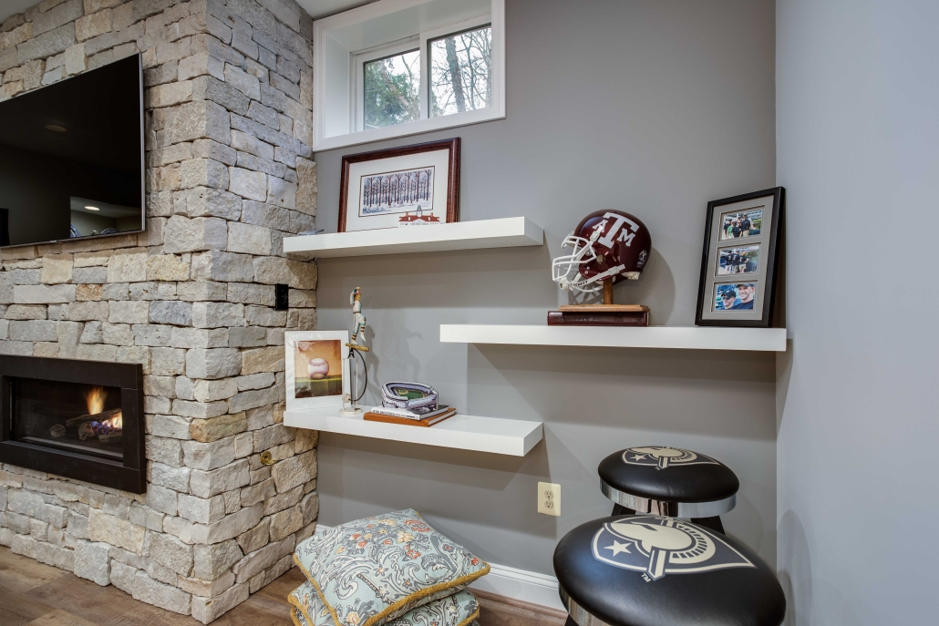 Basement remodel, Alexandria, VA with custom wood shelving and stone fireplace