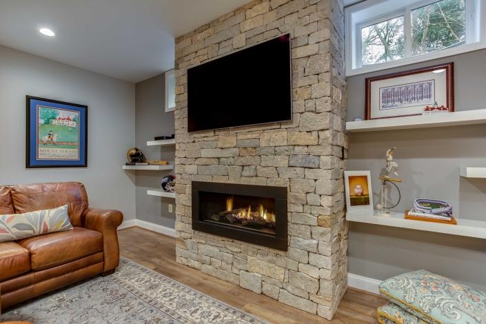 Gas fireplace insert, Alexandria, VA, basement remodeling, custom floating shelves