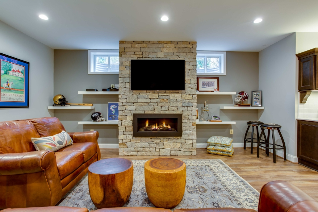 Basement suite, remodeling TV mounted on Pine County Ledger stone fireplace