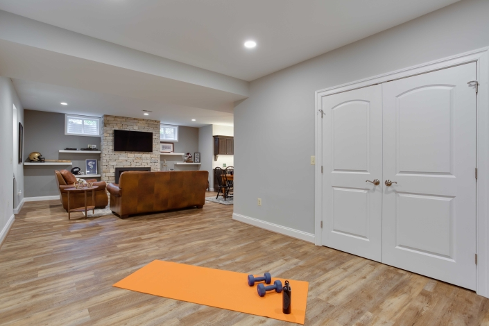 Work out area, basement remodel, Alexandria, VA with Happy Feet LVP flooring