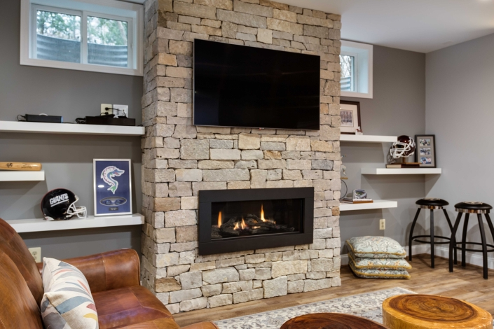 basement suite remodel, Alexandria, VA with Centercut Pine County Ledger stone on fireplace