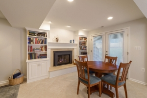 Annandale basement remodel with built in fireplace surround