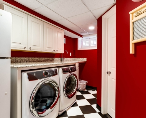 Arlington, laundry room remodel with Waypoint Living cabinets and granite countertops