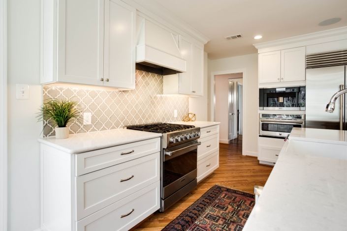 kitchen custom remodeling, Waypoint cabinets, Top Knobs chrome hardware and Cambria Swanbridge countertops