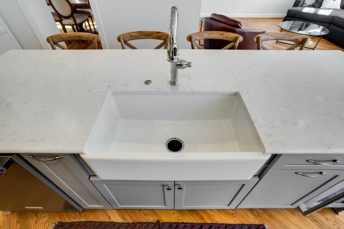 Arlington, VA kitchen remodeling with Cambria Swanbridge countertops, Newport Brass pull out faucet and Kohler cast iron apron front sink