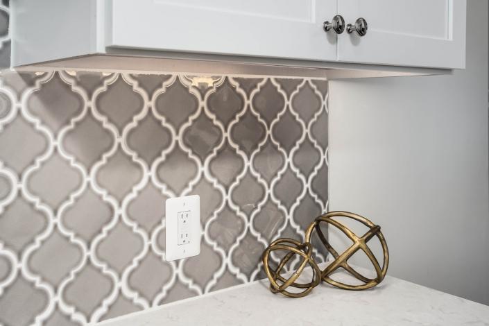 Arlington, VA design build remodeling with MIS Highland Park Dove Gray Arabesque tile backsplash