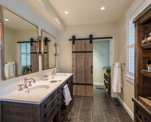 Great Falls, VA, custom master bath remodel with Vermont black porcelain tile on floor and barn style sliding door