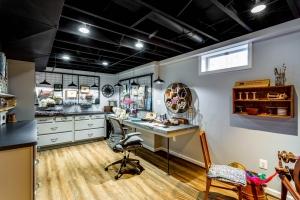 Custom remodeling, basement, craft room, Herndon, VA with Wilsonart countertop and Waypoint cabinets