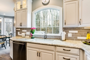 Kitchen Remodeling, Springfield, VA with custom Anderson arch window, glass backsplash and Cambria Berwin countertops