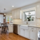 Bright kitchen remodel with white Crystal cabinets, Botticino Bianco backsplash in cream
