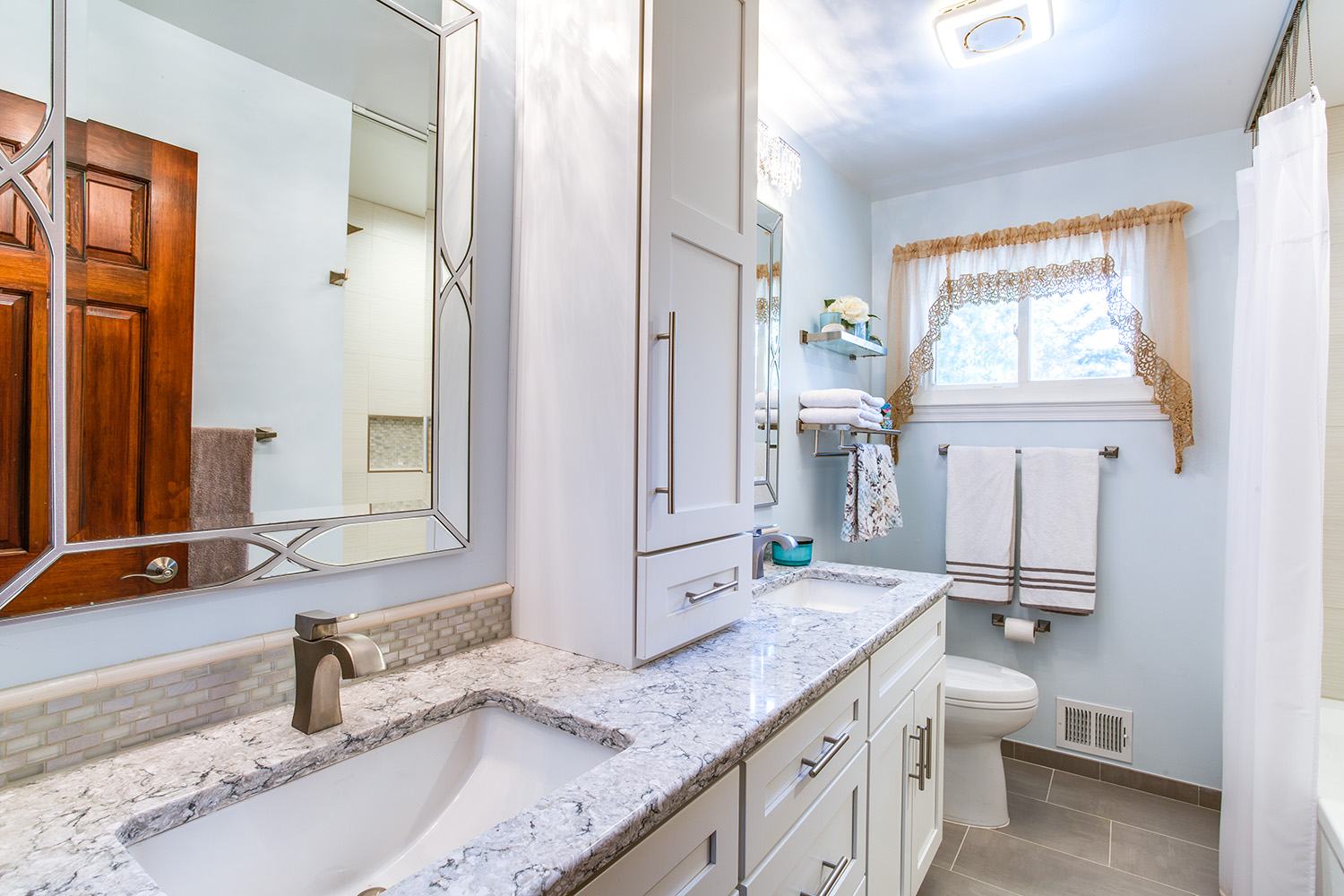 Springfield Bathroom remodel with Crystal cabinets in Maple and Silestone countertops