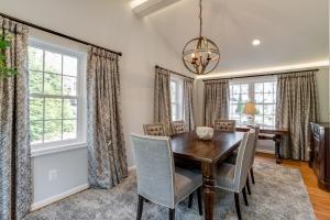 Interior remodeling, Vienna, VA updated dining room featuring custom light fixture and hardwood floors