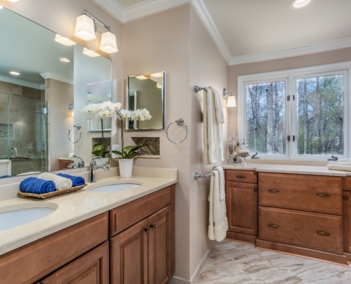 Aging in Place Bathroom Remodel Woodbridge with Waypoint cabinets finished with a Spice stain and Cambria Fairbourne countertops