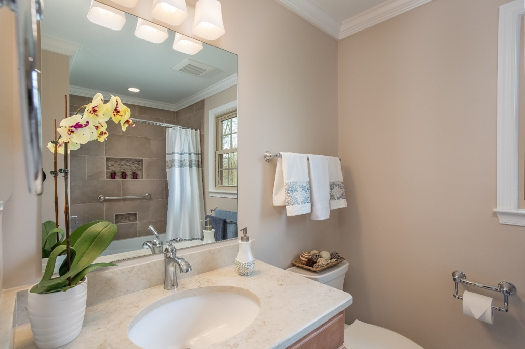 Woodbridge Hall Bathroom Remodel with Ceaserstone Taj Mahal vanity top and Sherwin Williams Cedar Key paint color