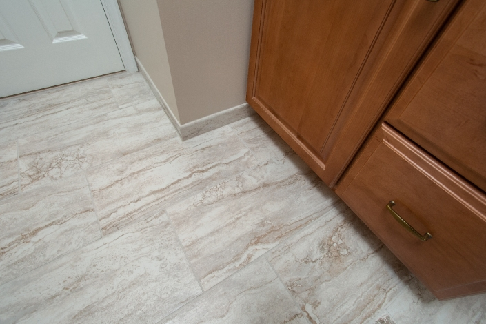 Woodbridge Hall Bathroom Remodel featuring MSI Bernini porcelain tile flooring