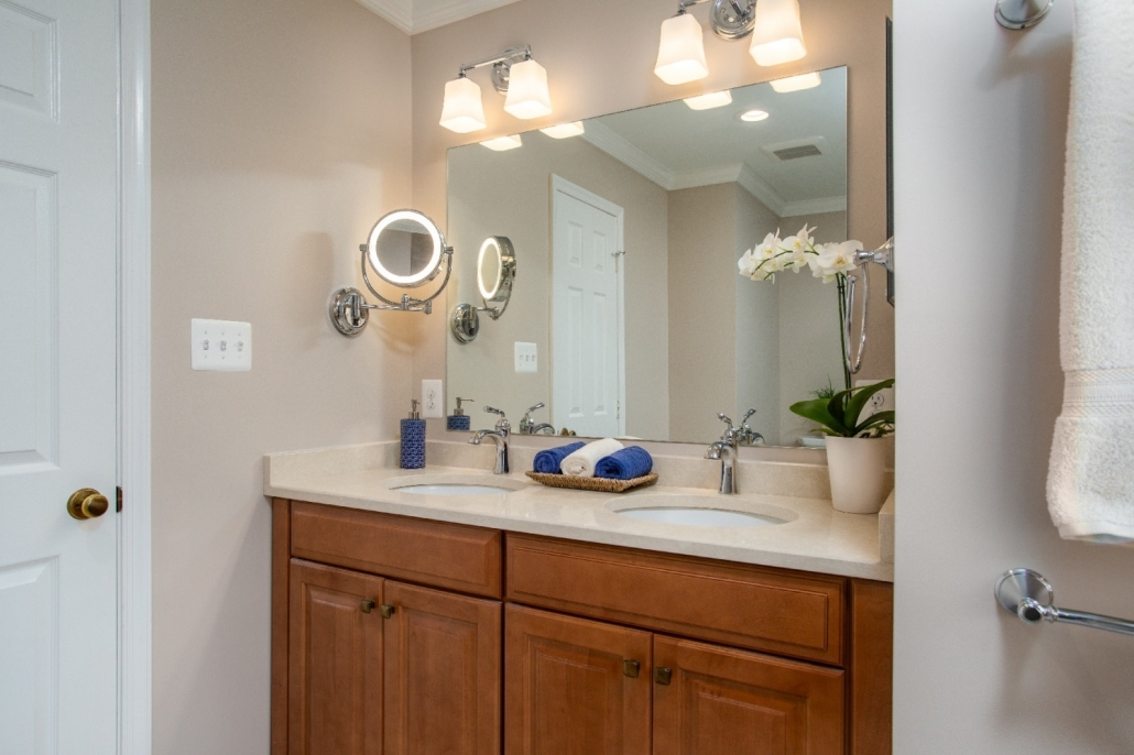 Woodbridge Master Bathroom Remodel with double sided polished chrome make-up mirror