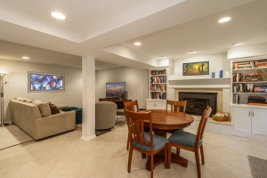 Annandale basement remodel with custom fireplace surround