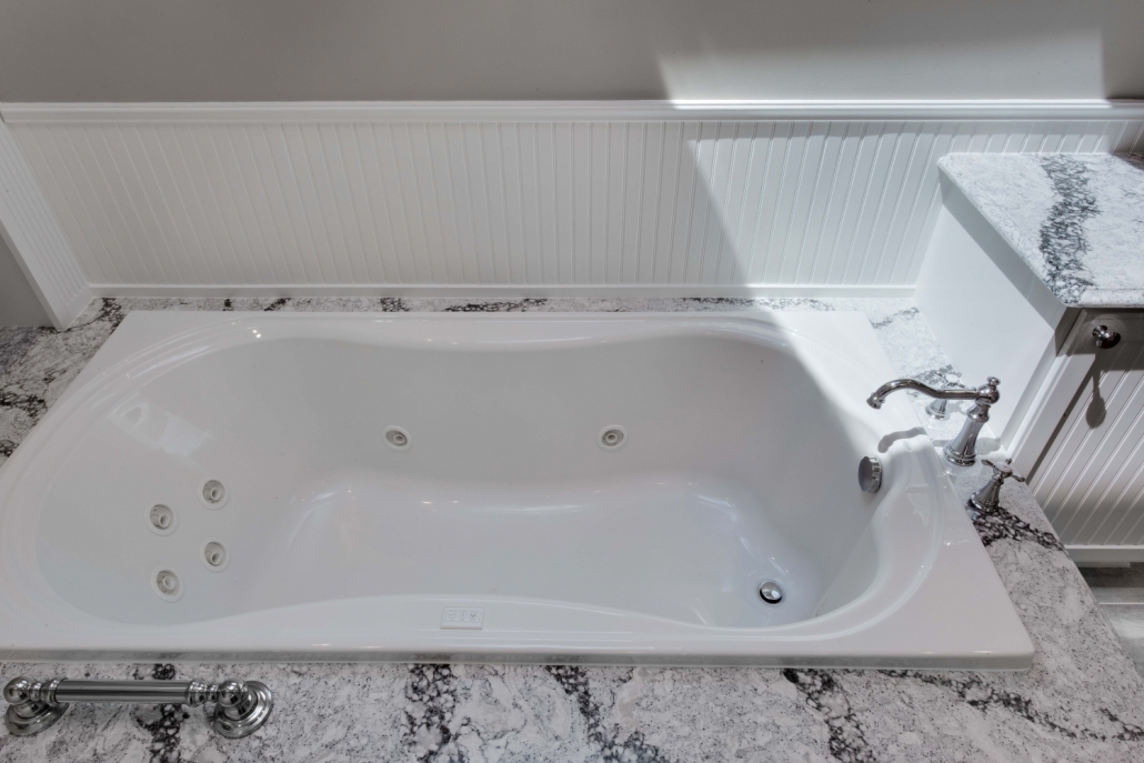 Fairfax Station Master Bath Remodel featuring Mirabelle whirlpool soaking tub with Wainscoated walls and Cambria Seagrove surround