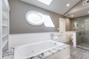 Fairfax Station Master Bath Remodel featuring Mirabelle Key West soaking tub with Cambria Seagrove tub deck