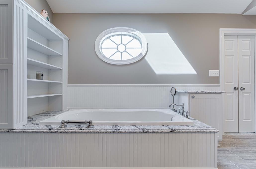 Fairfax Station Master Bath Remodel with beadboard Wainscoating, custom shelving and Mirabelle whirlpool soaking tub