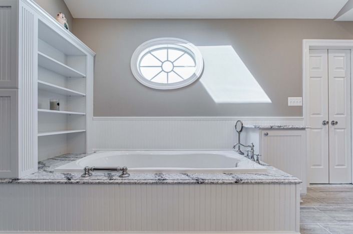 Fairfax Station Master Bath Remodel with beadboard Wainscoating, custom shelving and Mirabelle whirlpool soaking tub