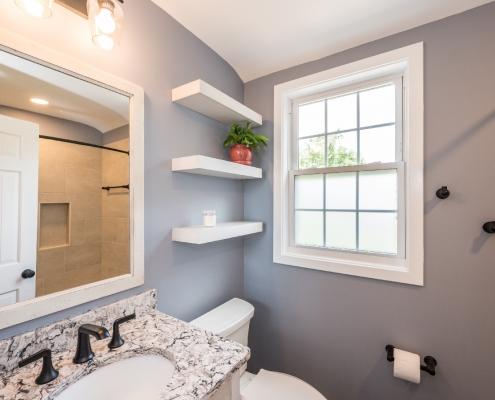 Arlington cozy bath remodel with floating shelves