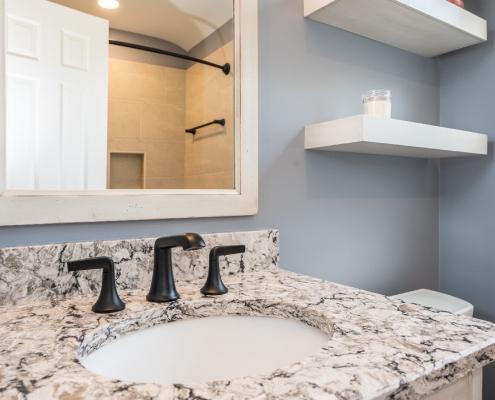 Bathroom remodel featuring granite countertop and oil rubbed bronze fixtures