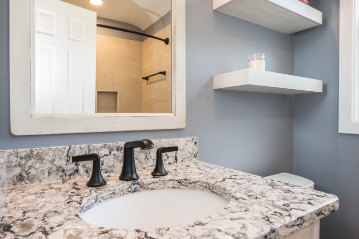 Bathroom remodel featuring granite countertop and oil rubbed bronze fixtures