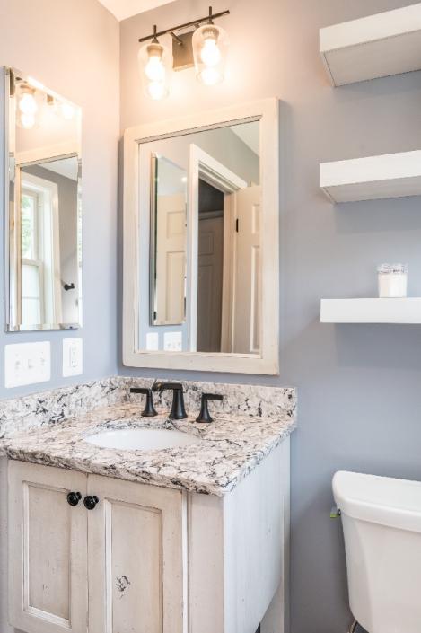 Rustic bathroom remodel in Arlington with custom vanity and mirror