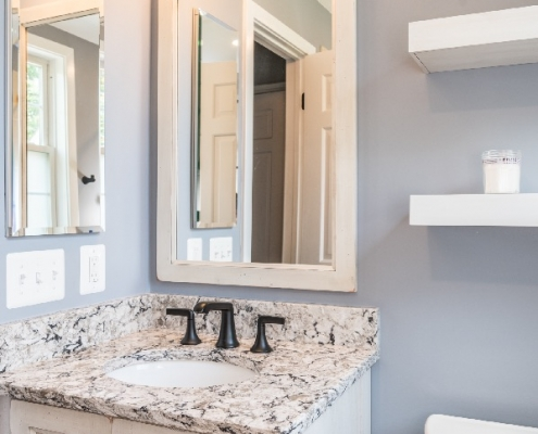 Rustic bathroom remodel in Arlington with custom vanity and mirror
