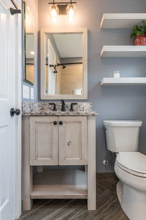 Cozy bath remodel Arlington with rustic vanity and floating shelves