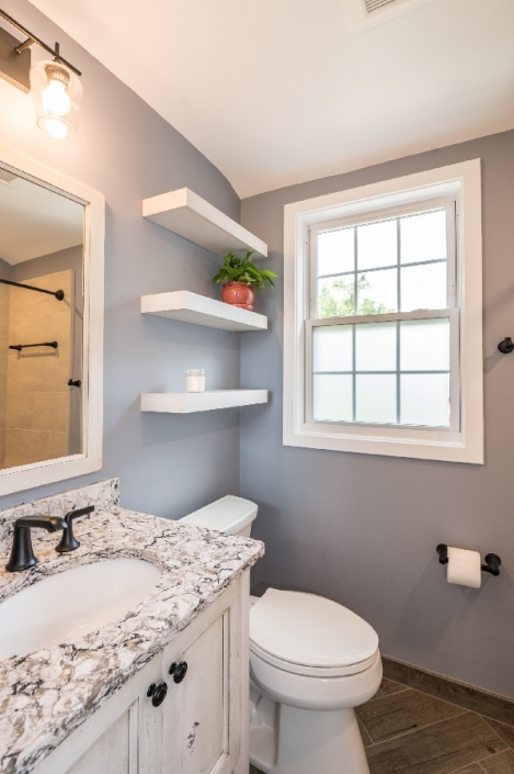 Arlington, VA bathroom remodel with granite countertops and farmhouse vanity