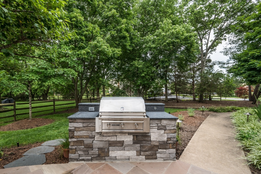 Patio and outdoor grilling area with stacked brick custom grill counter